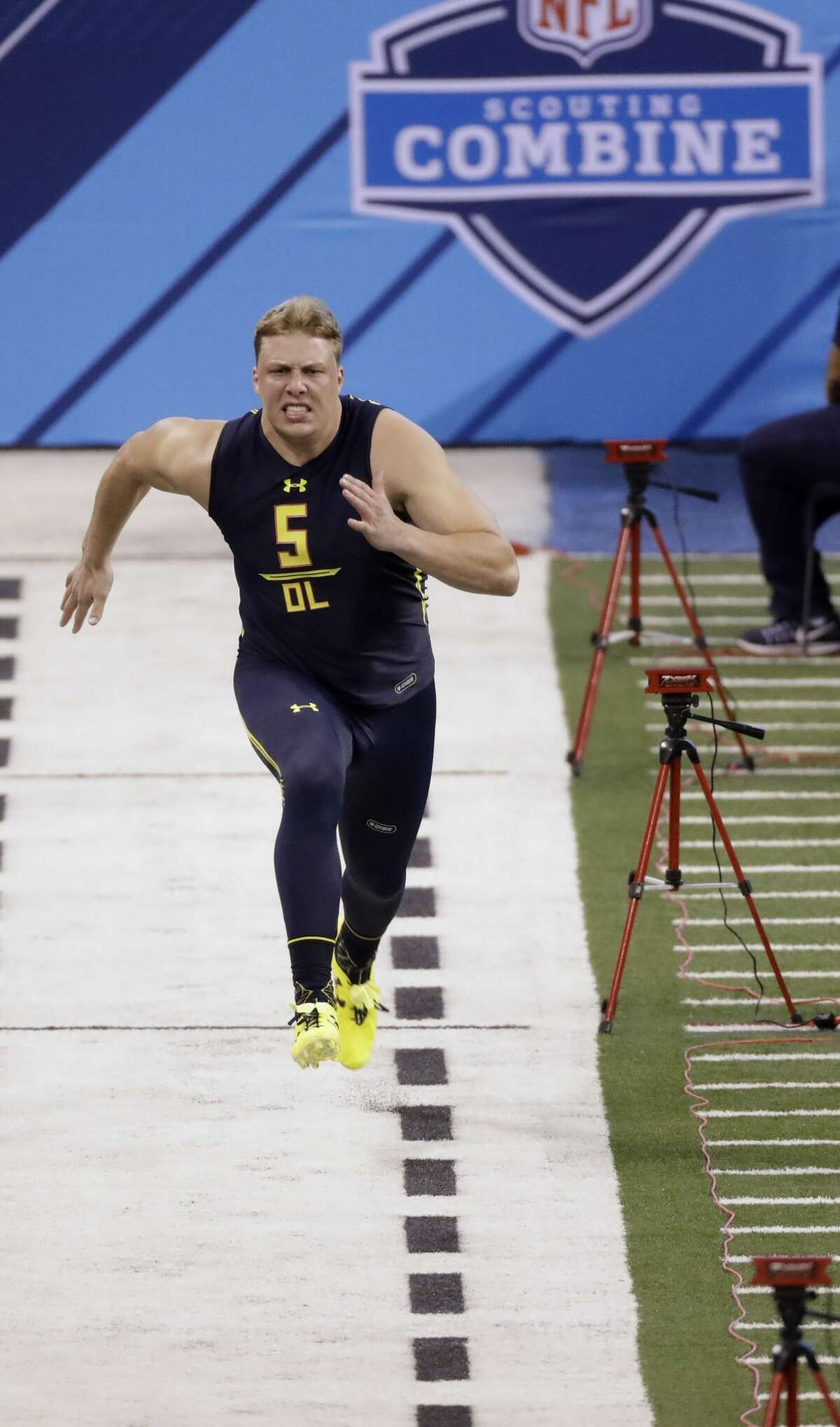 Utah offensive lineman Garett Bolles runs the 40-yard dash at the NFL football scouting combine Friday, March 3, 2017, in Indianapolis. (AP Photo/David J. Phillip)