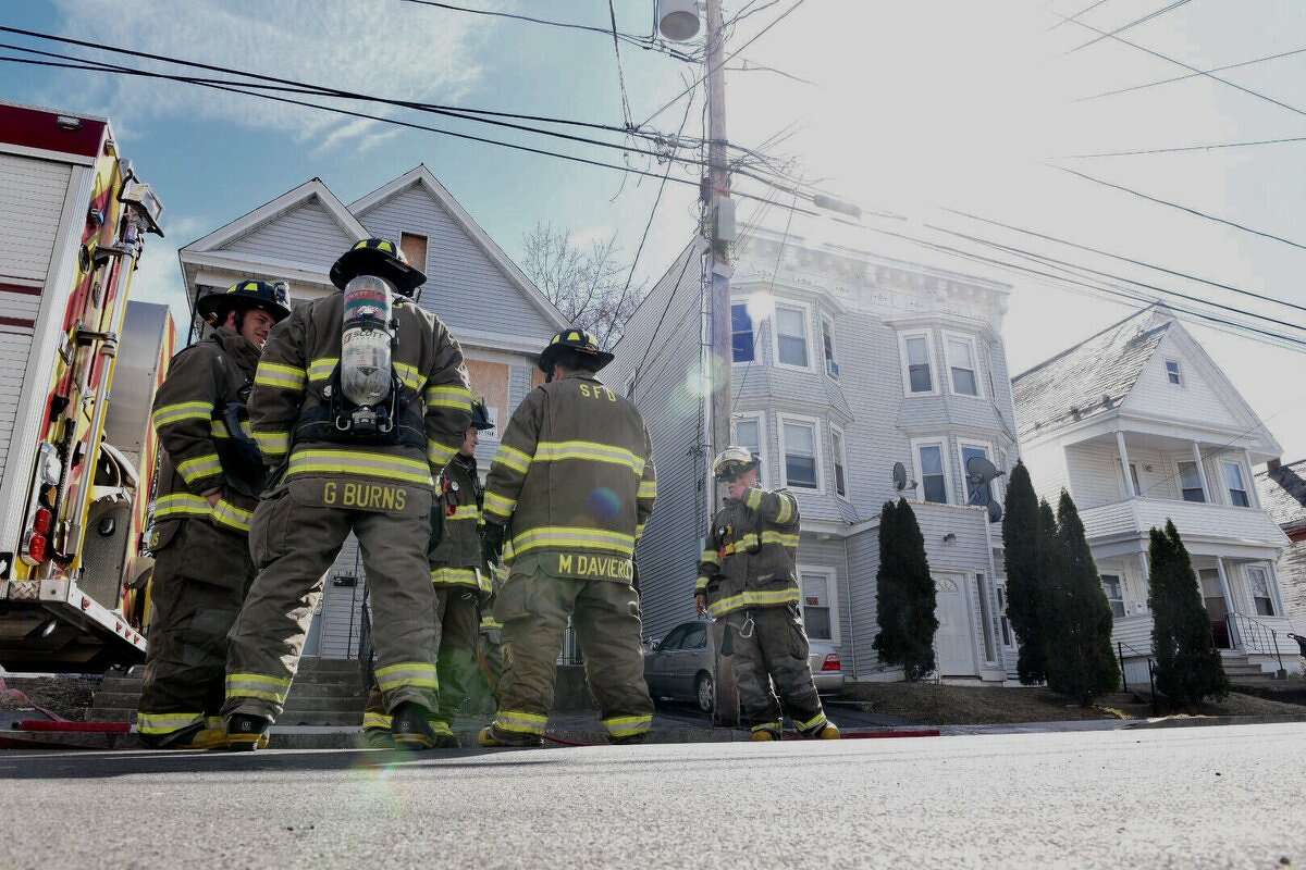 Firefighters tackled a blaze on the porch of a Carrie Street home in Schenectady on Friday. (Will Waldron / Times Union)