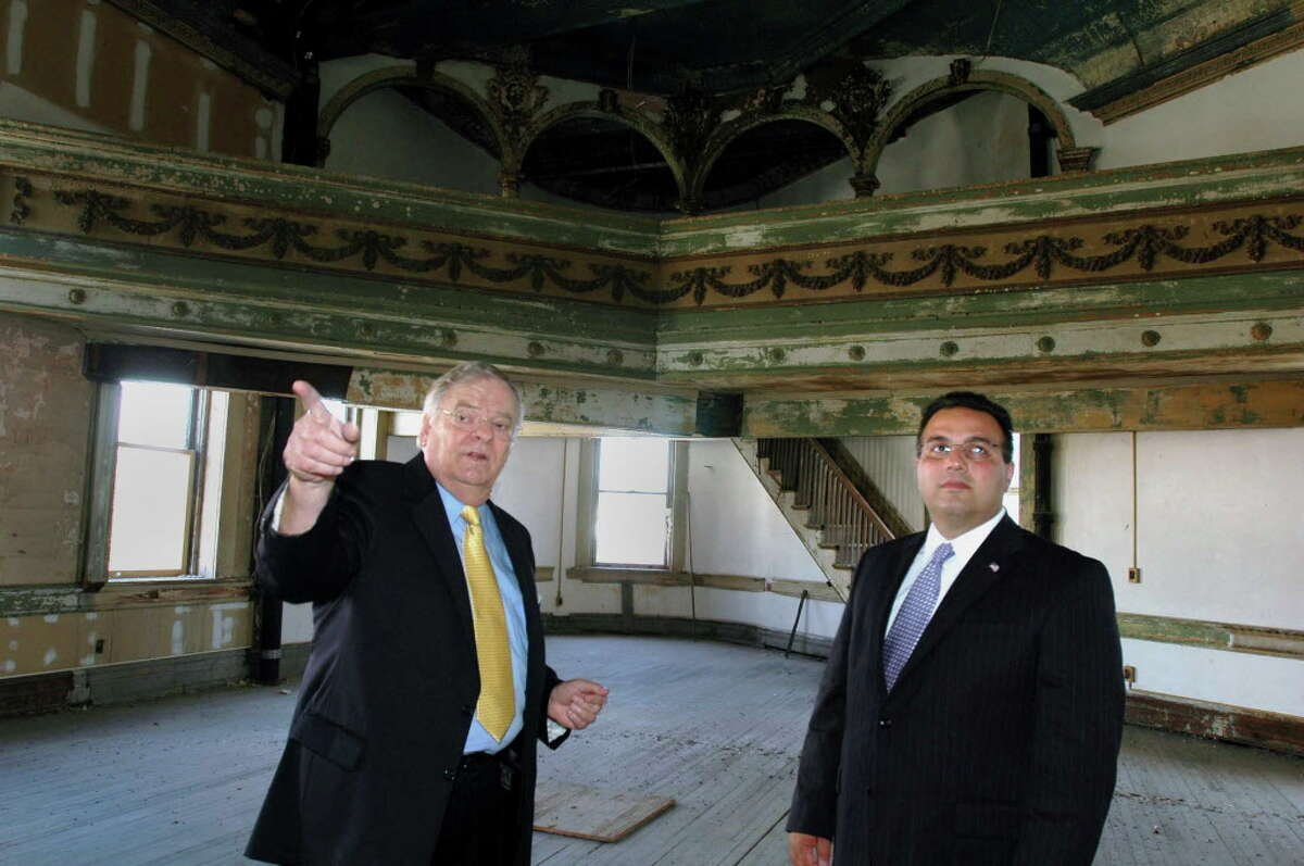 TIMES UNION STAFF PHOTO BY LUANNE M. FERRIS Thursday, Sept. 8, 2005, Troy, NY, Local Business owner John Hedley, has big plans for the John Scanlon Market Block Inc. he is developing at River and Third Sts. Here is Hedley with Troy Mayor Harry Tutunjian in one of the building's ball rooms to be restored. Hedley hopes there will be retail shops and office space for the rest of the facility.