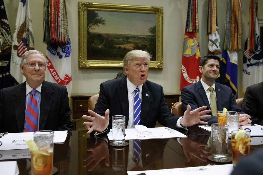President Donald Trump, flanked by Senate Majority Leader Mitch McConnell of Ky., left, and House Speaker Paul Ryan of Wis., speaks during a meeting with House and Senate leadership, Wednesday, March 1, 2017, in the Roosevelt Room of the White House in Washington. (AP Photo/Evan Vucci) Photo: Evan Vucci / Associated Press / Copyright 2017 The Associated Press. All rights reserved.