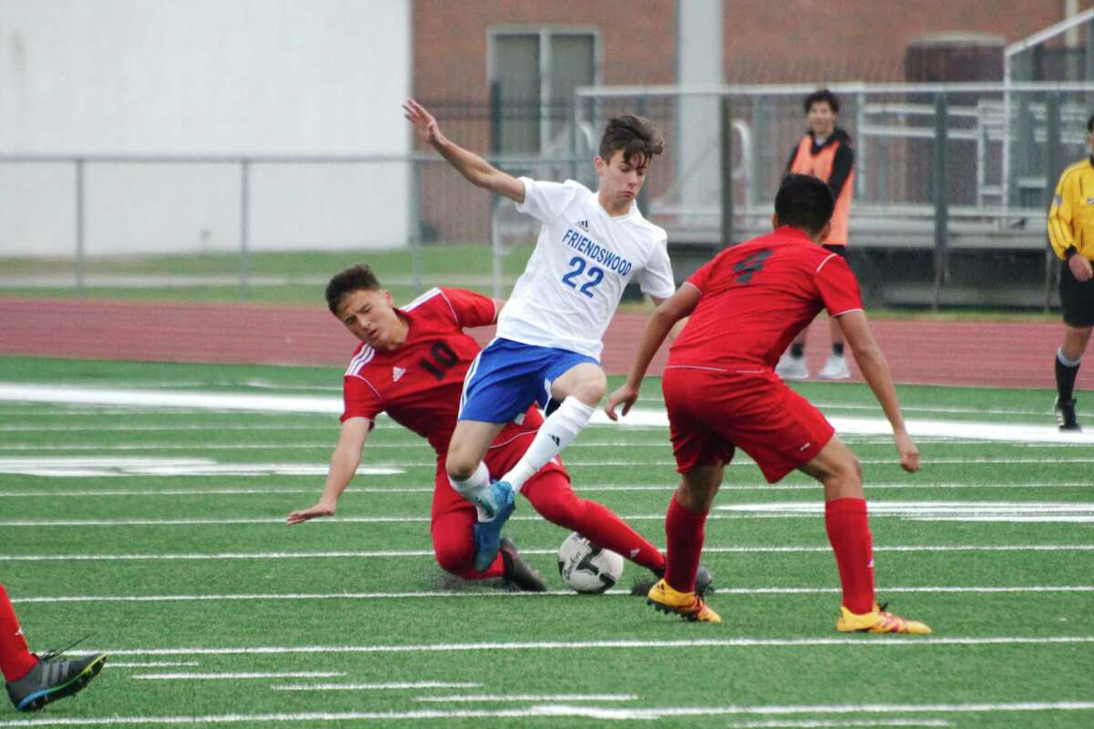Friendswood's Cory Thornton finds himself trapped between two Goose Creek Memorial defenders in the Friendswood Soccer Invitational.