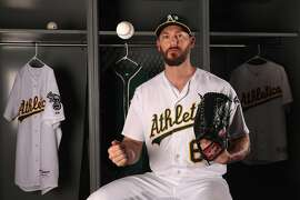MESA, AZ - FEBRUARY 22:  Pitcher John Axford #61 of the Oakland Athletics poses for a portrait during photo day at HoHoKam Stadium on February 22, 2017 in Mesa, Arizona.  (Photo by Christian Petersen/Getty Images)