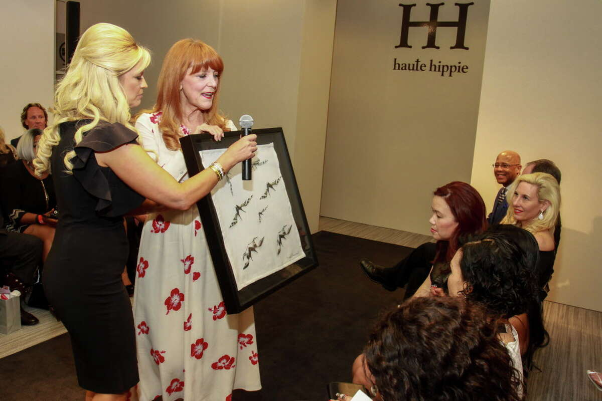 Chair Tammy Johnson, left, and founder Gracie Cavnar with an auction item at the Dress for Dinner event at Neiman Marcus. (For the Chronicle/Gary Fountain, March 2, 2017)