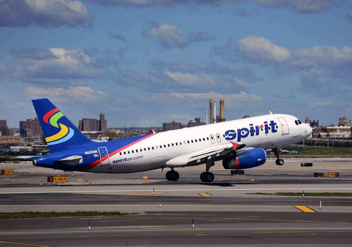 NEW YORK, NY - APRIL 28, 2015: A Spirit Airlines passenger aircraft (Airbus A320) takes off from LaGuardia Airport in New York City, New York.