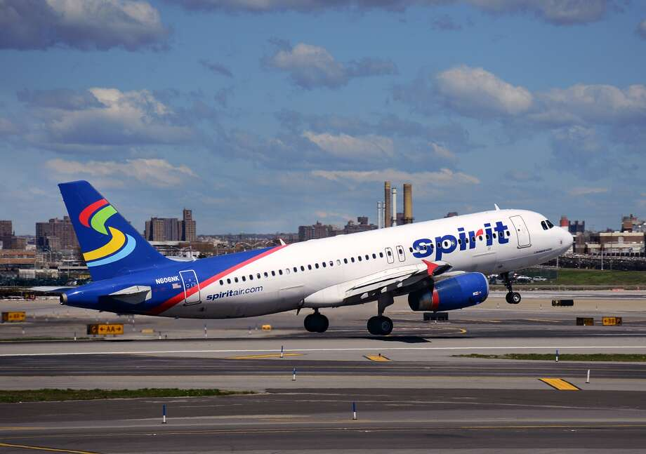 NEW YORK, NY - APRIL 28, 2015: A Spirit Airlines passenger aircraft (Airbus A320) takes off from LaGuardia Airport in New York City, New York. (Photo by Robert Alexander/Getty Images)