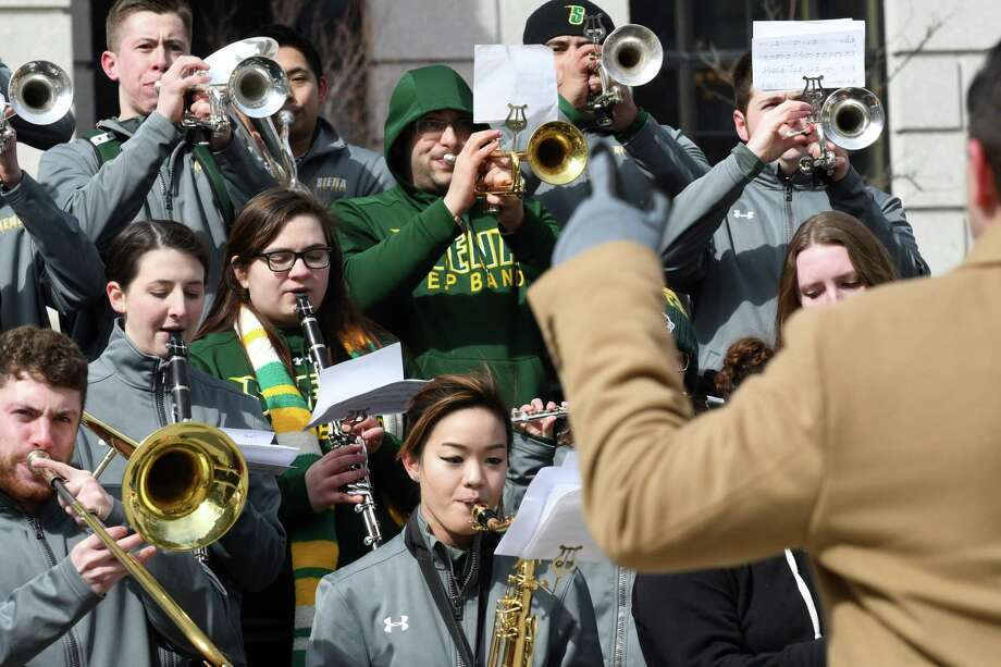 The Siena College pep band performs during a special lunchtime show with fellow MAAC Tournament team bands at West Capitol Park on Friday, March 3, 2017, in Albany, N.Y. (Will Waldron/Times Union) Photo: Will Waldron