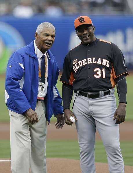 Former baseball player Felipe Alou, left, and the Netherlands' manager Hensley Meulens prepare to throw out the ceremonial first pitch before a semifinal game of the World Baseball Classic between the Netherlands and the Dominican Republic in San Francisco, Monday, March 18, 2013. (AP Photo/Jeff Chiu, Pool) Photo: Jeff Chiu, Associated Press