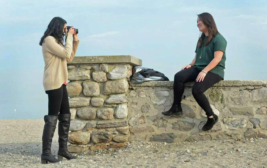 Shamika Pandit takes advantage of the mild weather to take a portrait photograph of Rachel Chang at Compo Beach in Westport on Feb. 22. Photo: Erik Trautmann / Hearst Connecticut Media / Norwalk Hour