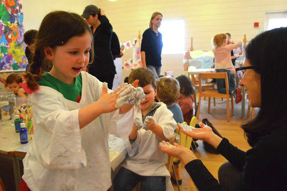 Jackie Nevin of Darien and her kids, Grace, 4, and William, 2, enjoy being dirty at the Open Art Studio for Kids at Grace Farms in New Canaan on Feb. 25. Photo: Jarret Liotta / For Hearst Connecticut Media / New Canaan News Freelance