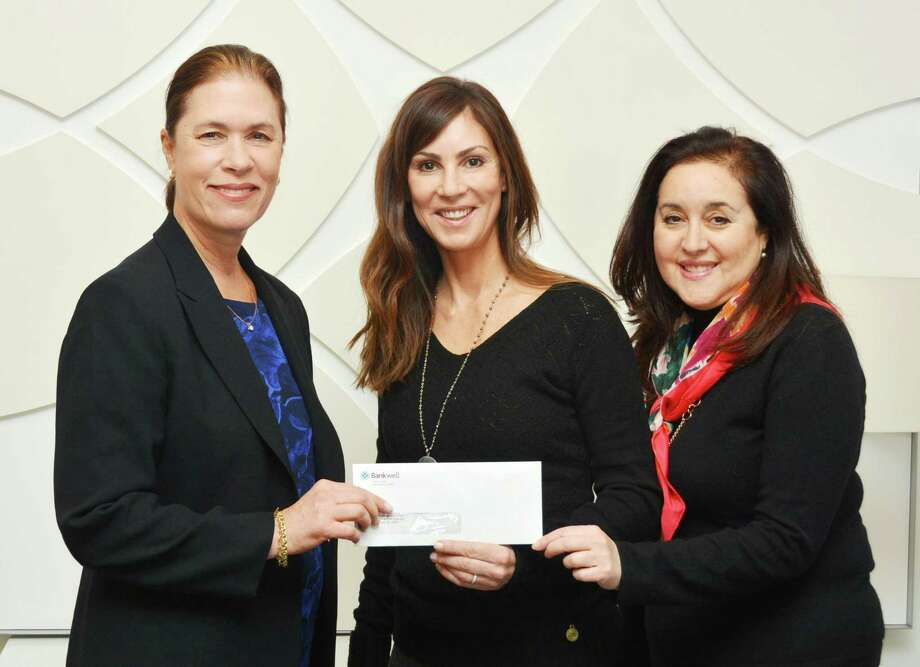 Bankwell Executive Vice President and Chief Lending Officer Heidi DeWyngaert, left, presents a check for $2,500 to Child Advocates of Southwestern Connecticut Board Member Nancy Rebold, center, and Executive Director Stacey Sobel. Photo: Contributed Photo / Contributed Photo / New Canaan News