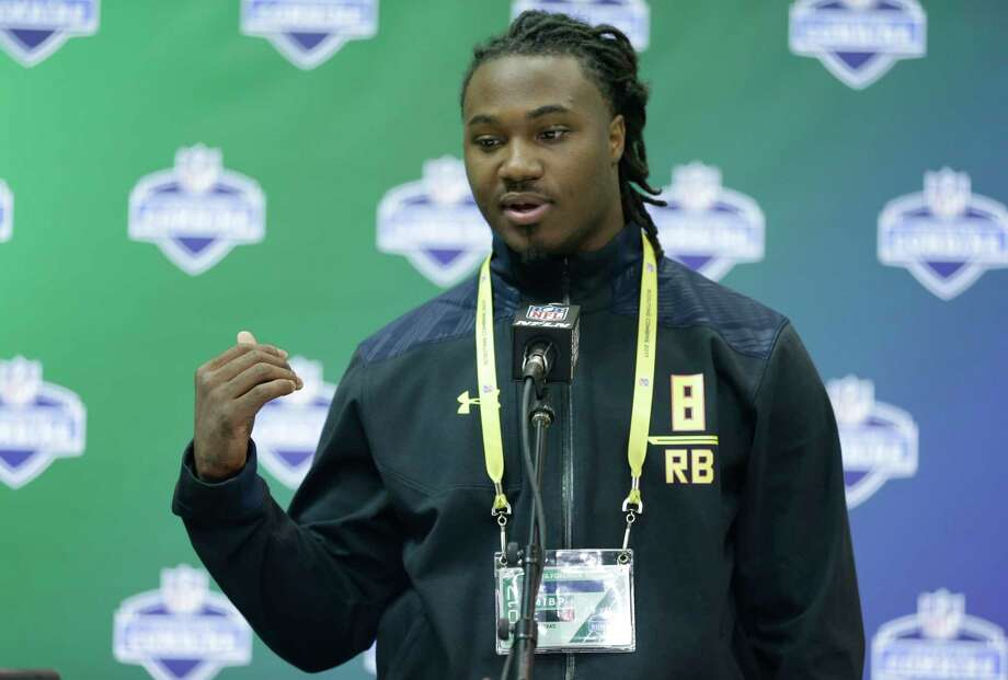 Texas running back D'Onta Foreman answers questions during a press conference at the NFL Combine in Indianapolis, Thursday, March 2, 2017. (AP Photo/Michael Conroy) Photo: Associated Press / Copyright 2017 The Associated Press. All rights reserved.