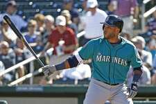 Seattle Mariners second baseman Robinson Cano bats against the Cleveland Indians during the first inning of a spring training baseball game Wednesday, March 1, 2017, in Goodyear, Ariz. The Mariners defeated the Indians 7-4. (AP Photo/Ross D. Franklin)