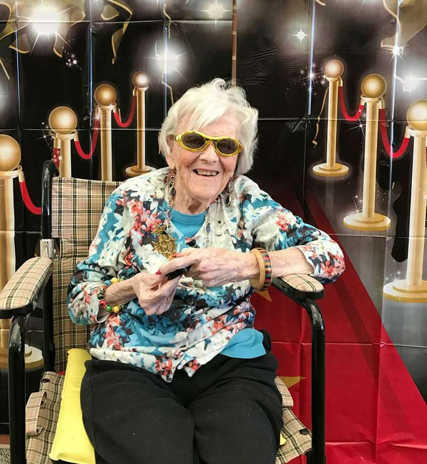 Lorraine McGettigan, a resident of The Village at Waveny, poses on the red carpet on Feb. 6. Photo: Contributed Photo / New Canaan News
