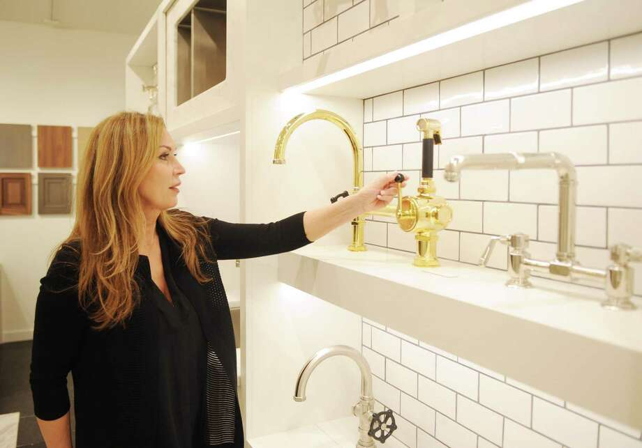 Waterworks General Manager Suzanne Blum shows off faucets on display at the store's newly expanded showroom on West Putnam Avenue in Greenwich. Photo: Tyler Sizemore / Hearst Connecticut Media / Greenwich Time