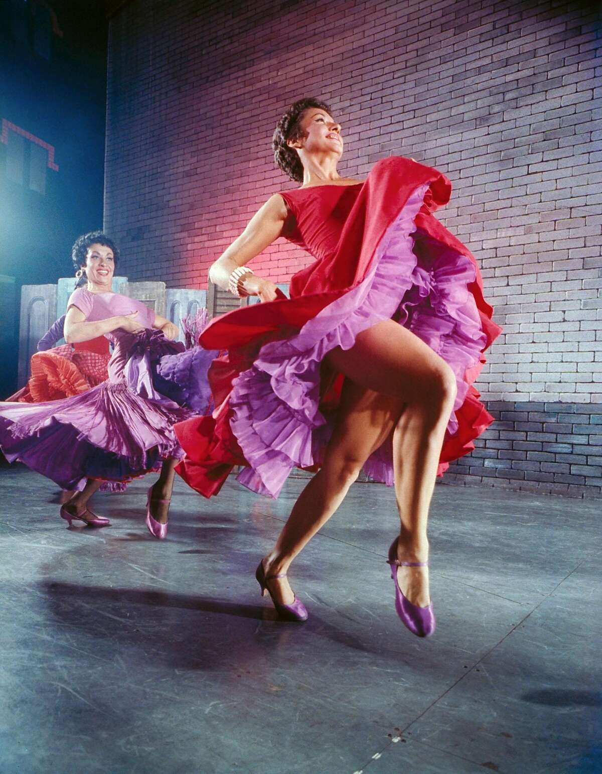 Actresses Chita Rivera (R) and Liane Plane dancing in a scene fr. the Broadway production of West Side Story. (Photo by Hank Walker/The LIFE Picture Collection/Getty Images)