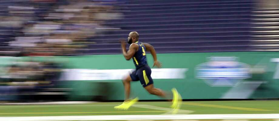 In this image taken with a slow shutter speed, LSU running back Leonard Fournette runs the 40-yard dash at the NFL football scouting combine Friday, March 3, 2017, in Indianapolis. (AP Photo/David J. Phillip) Photo: David J. Phillip, Associated Press / Copyright 2017 The Associated Press. All rights reserved.