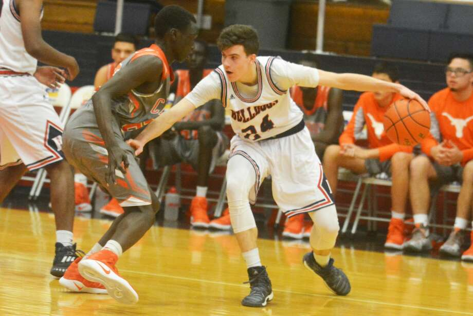 Plainview's Bryson DeBerry, right, was voted to the All-District 3-5A first team. The 6-foot-5 senior averaged 11.6 points and 6.3 rebounds per game. He shot 50 percent from the field and 78 percent from the foul line. Photo: Skip Leon/Plainview Herald