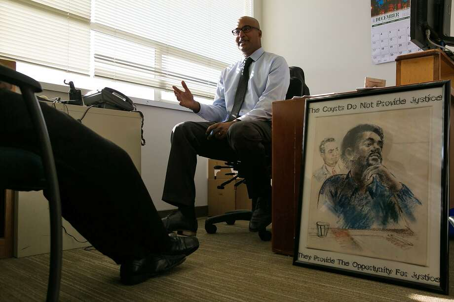 Manohar Raju, who manages the felony unit of the San Francisco public defender's office, talks to a client. Photo: Mason Trinca, Special To The Chronicle