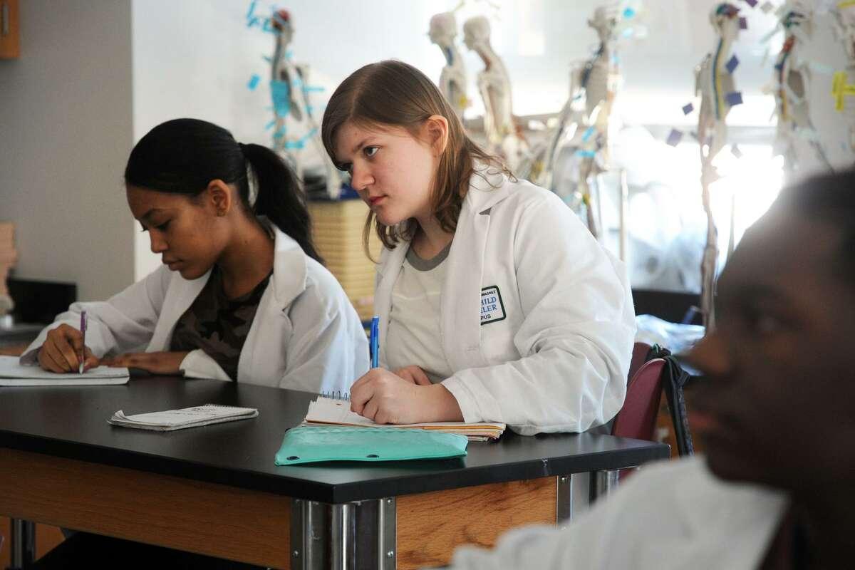 Lauren Wokanovicz, right, of Shelton, and Neilissa Dagraca, left, of Stratford, both sophomore Biotech students at Fairchild Wheeler Interdistrict Magnet School attend their Human Phsiology class in Bridgeport, Conn. March 2, 2017.