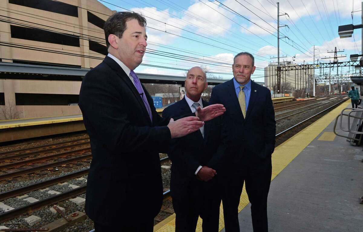 State Representative Chris Perone (D-Norwalk), Connecticut Construction Industries Association President Don Shubert and Speaker of the House Joe Aresimowicz (D-Berlin/Southington) discuss transportation issues after Perone was named Chief Transportation Financial Officer for House Democrats during a news conference Friday. March 3, 2017, at the South Norwalk Train Station in Norwalk, Conn.