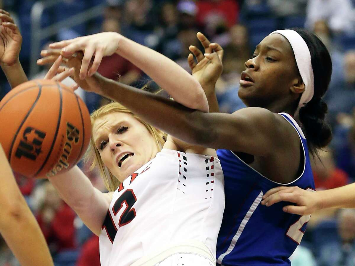Tiger forward Ciarra Mutshatshi (right) battles the Lady Eagles star Vivian Gray for a rebound as Wharton plays Argyle in the 4A state girls basketball semifinals at the Almodome in San Antonio on March 3, 2017.