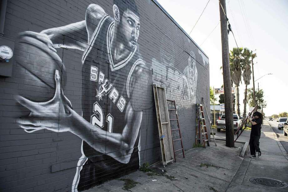 Well known area artist Nick Soupe is canvassing the side of the bar with an enormous mural dedicated to Tim Duncan at Franky Diablo's on Thursday, February, 23, 2017. Photo: Carlos Javier Sanchez / For The Express News / Carlos Javier Sanchez / For The Express News / SABJ