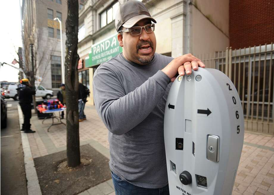 Kelvin Ayala, owner of Moe's Burger Joint at 997 Main Street in Bridgeport, says that the new automated parking meter system is discouraging visitors from patronizing downtown businesses, in Bridgeport, Conn. on Tuesday, February 28, 2017. Photo: Brian A. Pounds / Hearst Connecticut Media / Connecticut Post