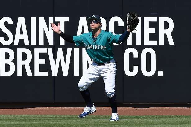 PEORIA, AZ - MARCH 02:  Tyler O'Neill #70 of the Seattle Mariners loses a fly ball in the sun during the first inning against the Milwaukee Brewers at Peoria Stadium on March 2, 2017 in Peoria, Arizona.  (Photo by Norm Hall/Getty Images)
