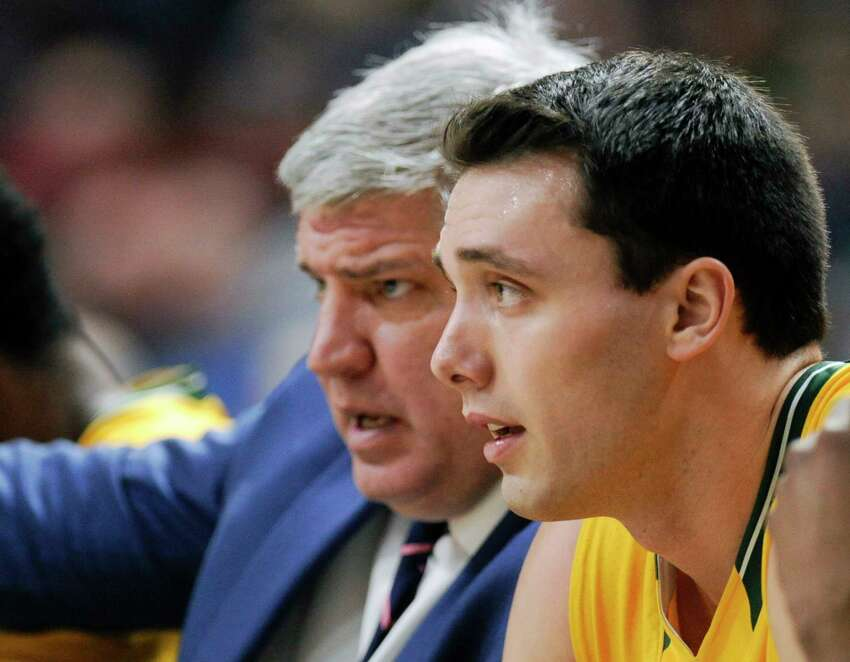 Siena head coach Jimmy Patsos, left, gives instructions to player Brett Bisping as he coaches his team against Niagara during the first half of an NCAA men's college basketball game in Albany, N.Y., Saturday, Feb. 18, 2017. (Hans Pennink / Special to the Times Union) ORG XMIT: HP107
