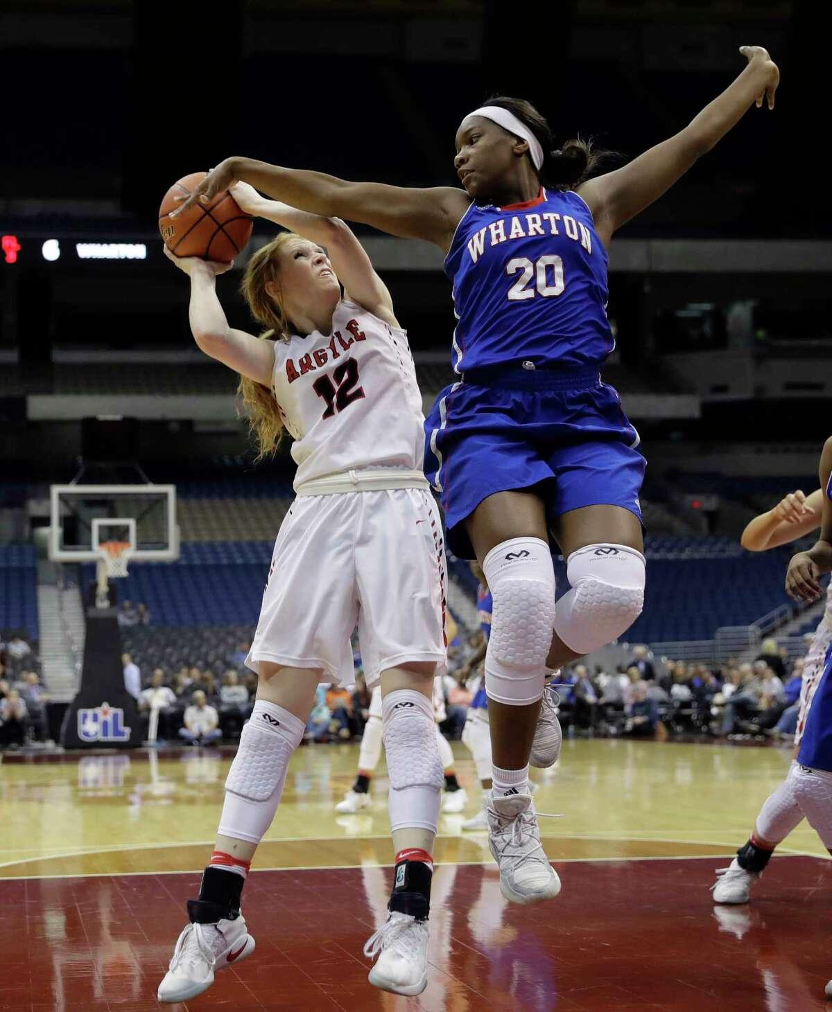 Argyle's Vivian Gray (12) looks to shoot past Wharton's Ciarra Mutshatshi (20) during a UIL Class 4A girls high school state semifinal basketball game, Friday, March 3, 2017, in San Antonio. Argyle won 71-31. (AP Photo/Eric Gay)