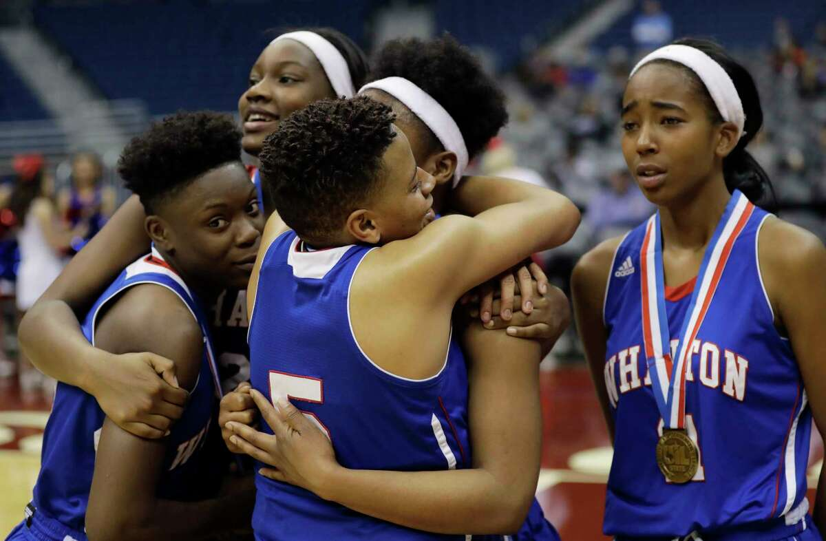 Wharton's Roberta Farris (5) hugs teammates following their loss to Argyle in a UIL Class 4A girls high school state semifinal basketball game, Friday, March 3, 2017, in San Antonio. Argyle won 71-31. (AP Photo/Eric Gay)