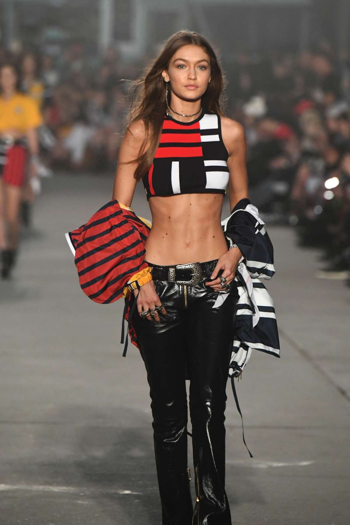 Model Gigi Hadid walks the runway at the TommyLand Tommy Hilfiger Spring 2017 Fashion Show. Keep clicking for more Gigi Hadid looks on the runway in 2017.