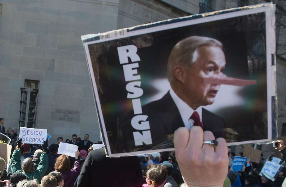 Protesters outside the Justice Department in Washington call for the resignation of U.S. Attorney General Jeff Sessions last week. Photo: NICHOLAS KAMM, AFP/Getty Images
