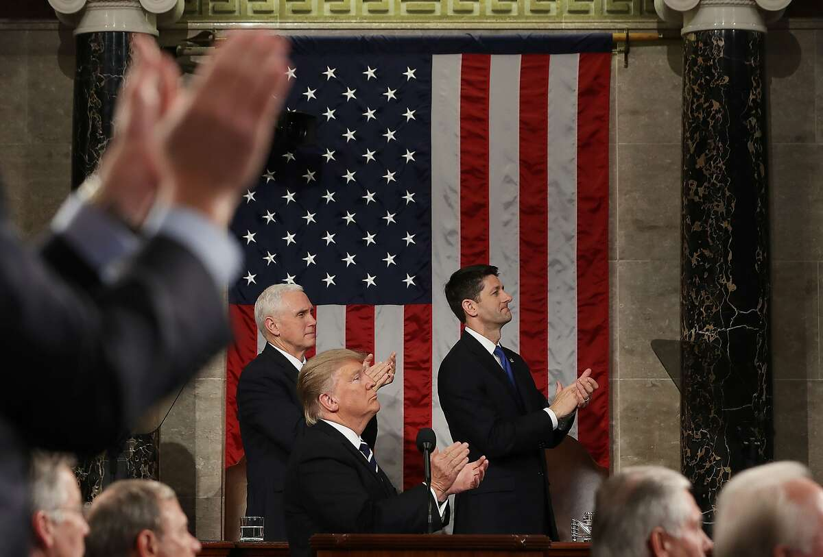 US President Donald J. Trump and the entire chamber reacts towards Carryn Owens, widow of Navy Seal Ryan Owens, as Trump delivers his first address to a joint session of Congress from the floor of the House of Representatives in Washington, DC, USA, 28 February 2017. Traditionally the first address to a joint session of Congress by a newly-elected president is not referred to as a State of the Union. / AFP PHOTO / EPA POOL / JIM LO SCALZOJIM LO SCALZO/AFP/Getty Images