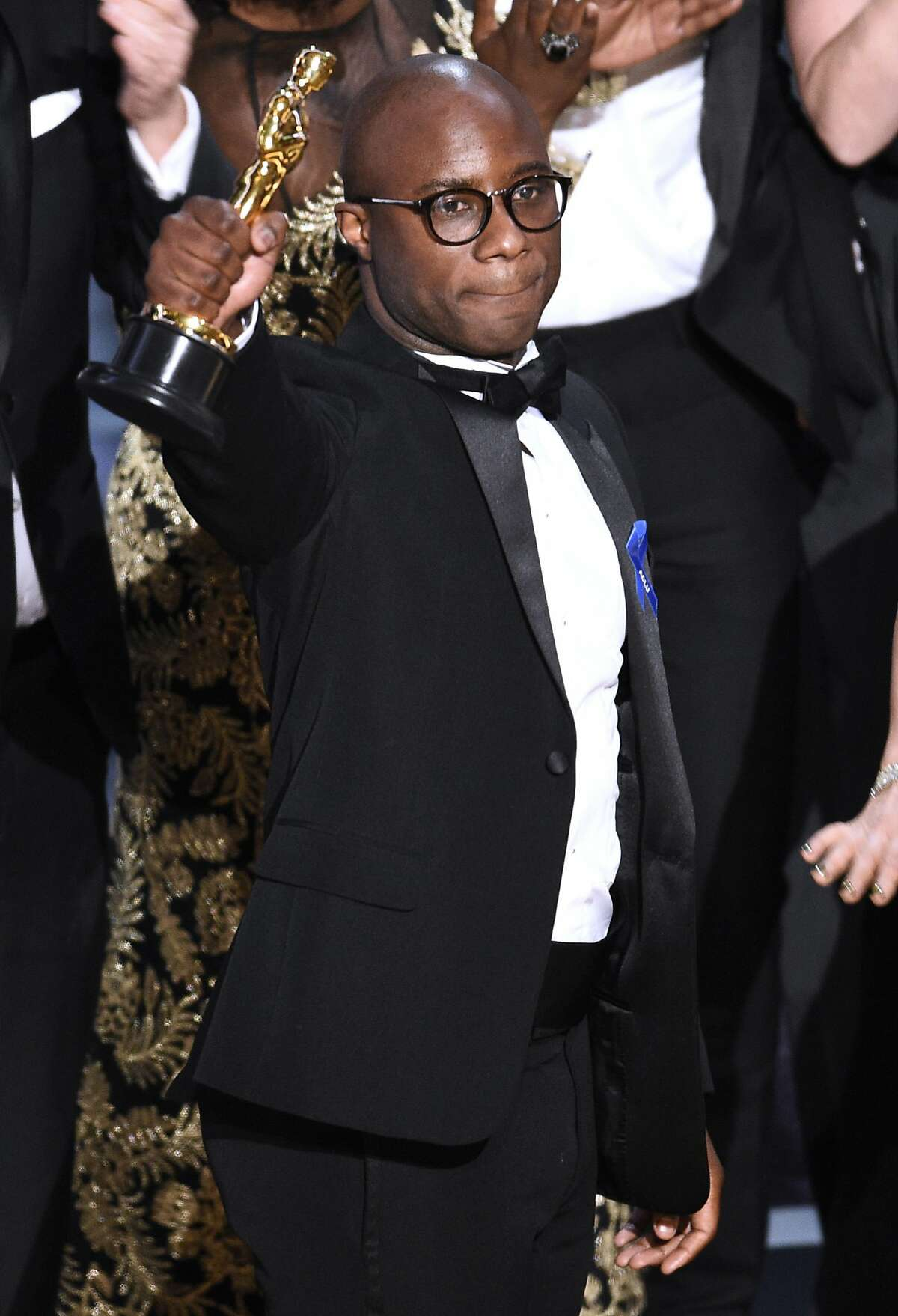 Barry Jenkins reacts after winning the award for best picture for