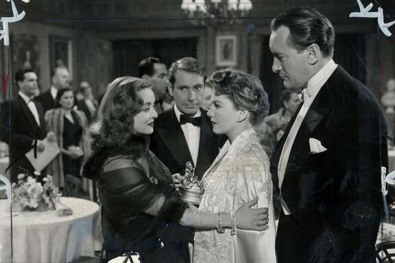 "Bette Davis, Gary Merrill, Anne Baxter, and George Sanders in ""All About Eve"""