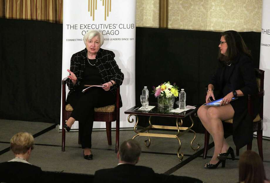 Federal Reserve Board Chair Janet Yellen speaks with the Executives Club of Chicago CEO Ana Dutra during a luncheon Friday. Yellen said that the Federal Reserve will likely raise the benchmark interest rate later this month. Photo: Joshua Lott /Getty Images / 2017 Getty Images