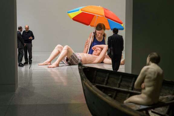 Ron Mueck's couple Under An Umbrella and Man in Boat are shown during a preview of an exhibit of Mueck's sculptures at the Museum of Fine Arts Houston on Wednesday, Feb. 22, 2017, in Houston. Mueck's sculptures will be on exhibit through the summer. ( Brett Coomer / Houston Chronicle )