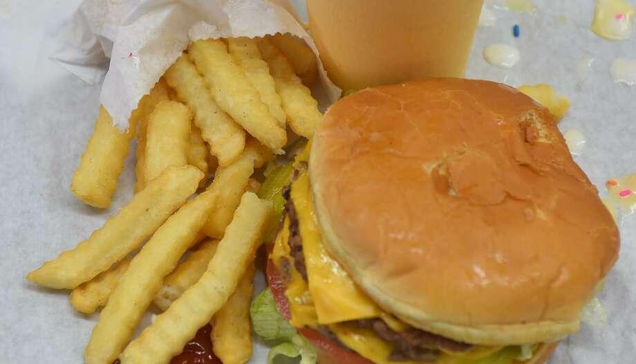 A burger boy, fries, and an orange shake from Burger Boy. Photo: Express-News File Photo / ROBERT JERSTAD