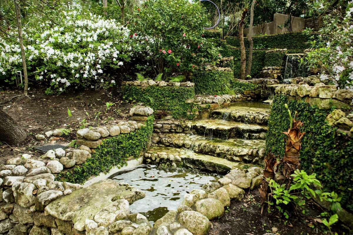 Texas limestone walls line a water feature. Some 66 percent of people surveyed chose hardscapes such as pavers or stone over garden beds or ground cover.