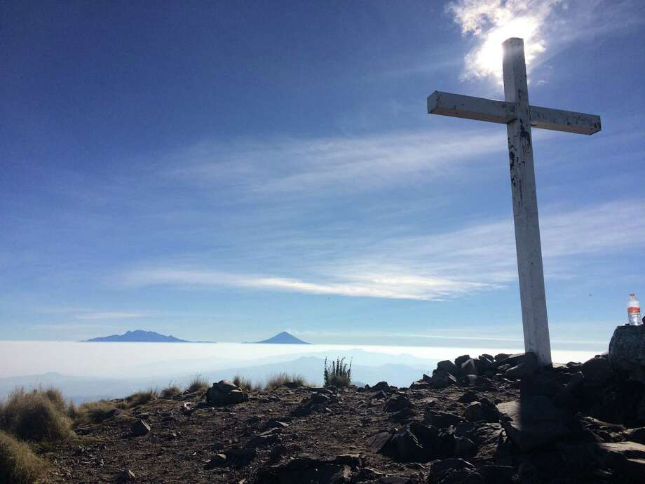 The summit of Ajusco, known locally as Cruz de Marquez. The Pass of Cortes is visible in the distance. Photo: St. John Barned-Smith