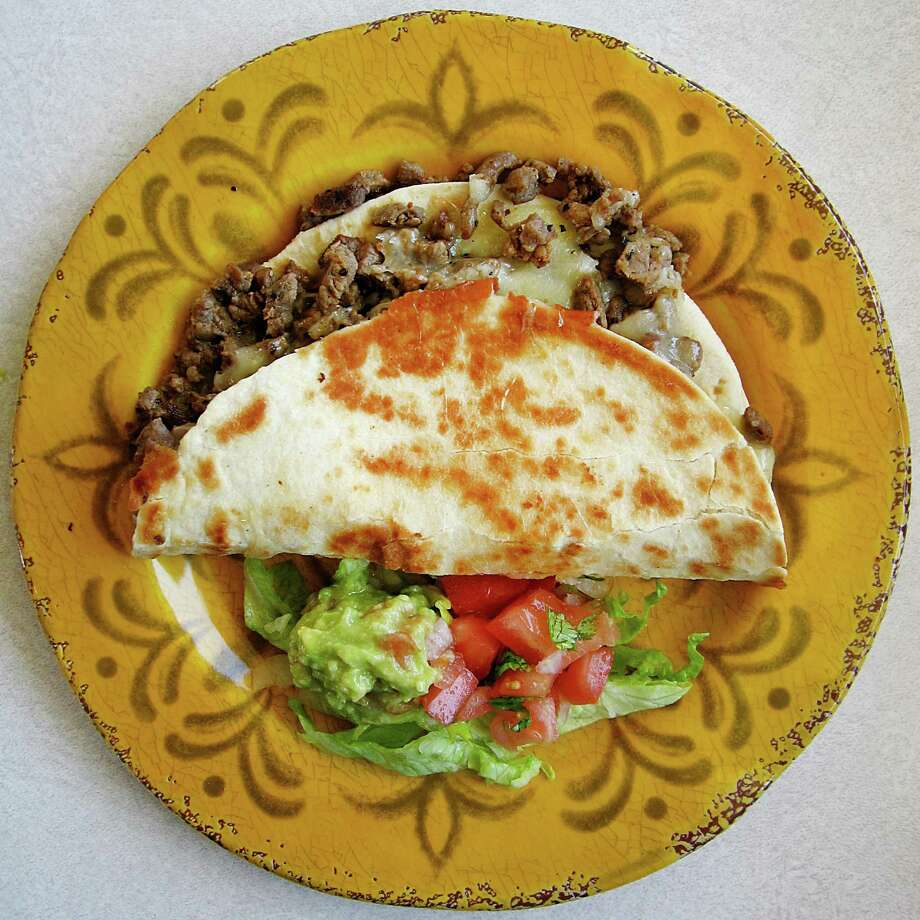 Beef fajita with cheese on a toasted, handmade flour tortilla from Taquería Los Dos Laredos on South Hackberry Street. Photo: Mike Sutter /San Antonio Express-News