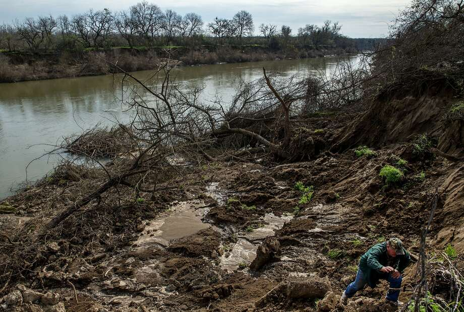 Phillip Filter walks out of his damaged land next to the Feather River in Live Oak (Suttery County). His land was flooded by the Feather River when the Oroville Dam overflowed and then eroded his property when the embankments collapsed. Photo: Santiago Mejia, The Chronicle