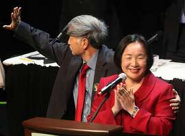 Oakland's new mayor Jean Quan (in red) with husband Floyd Huen after the inauguration at Fox Theater in Oakland, Calif., on Monday, January 3, 2011.