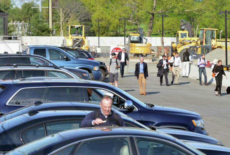 Commuters in the parking lot of the Old Greenwich Train Station head to their cars after getting off the train May 12, 2016. Permits for parking at Greenwich's train stations are difficult to come by. Wait lists have thousands of names on them. Photo: Bob Luckey Jr. / Hearst Connecticut Media / Greenwich Time