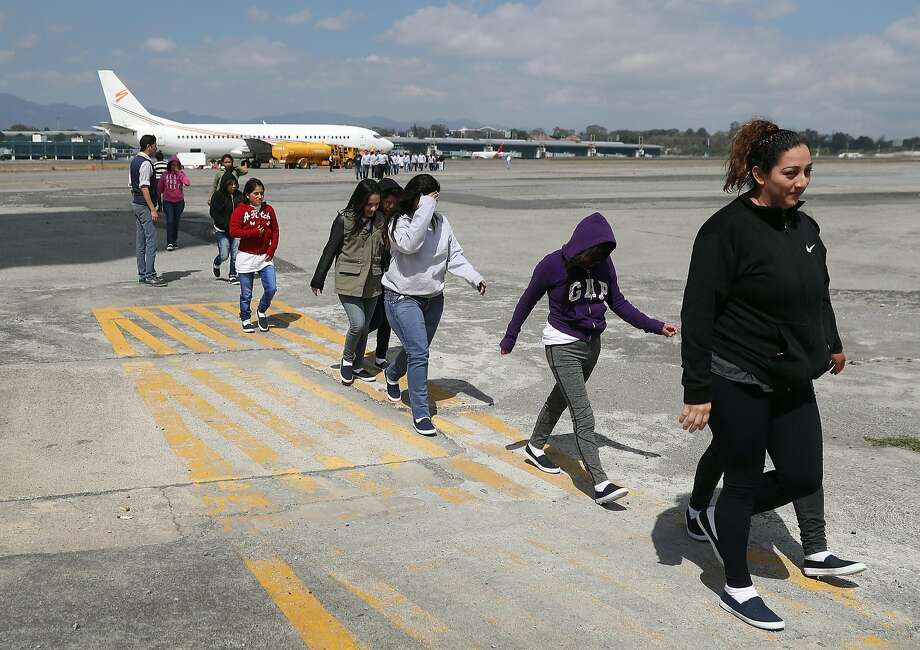 A group of Guatemalan immigrants exits an Immigration and Customs Enforcement agency jet in Guatemala City after their deportation from the United States last month. Photo: John Moore, Getty Images
