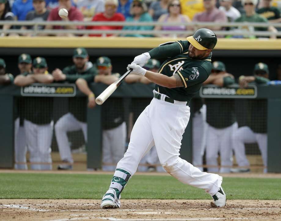 Oakland Athletics' Yonder Alonso hits a home run against the San Francisco Giants during the second inning of a spring training baseball game in Mesa, Ariz., Friday, March 3, 2017. (AP Photo/Chris Carlson) Photo: Chris Carlson, Associated Press