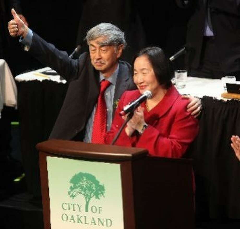Oakland Mayor Jean Quan in 2011 at her inauguration at Fox Theater, with her husband Floyd Huen. The couple are part owners of a medical cannabis dispensary in San Francisco's Outer Sunset. Photo: Matier And Ross, Liz Hafalia, San Francisco Chronicle