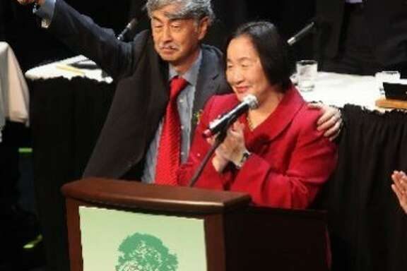 Oakland Mayor Jean Quan in 2011 at her inauguration at Fox Theater, with her husband Floyd Huen. The couple now hope to be part owners of a medical cannabis club in San Francisco's outer Sunset.