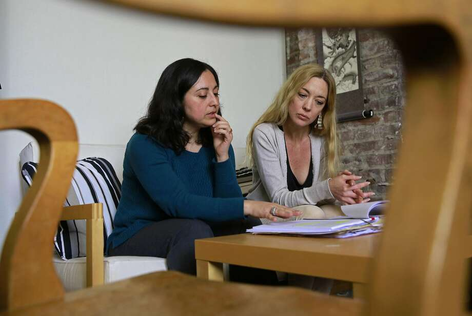 Senior staff Attorney Cecilia Candia, (left) and senior social worker Erin Maxwell at the offices of Legal Services for Children, in San Francisco. They represent a 14-year-old boy who fled extreme child abuse in Honduras and arrived in the United States with no one to take him in and had been held in custody for nearly a year. He was released to a Spanish-speaking foster home on March 13, nine days after his story appeared in The Chronicle. Photo: Michael Macor, The Chronicle
